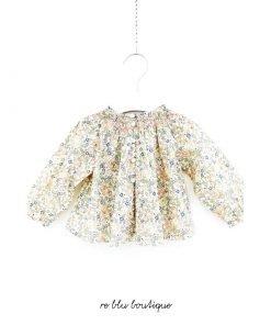 Blusa Bonpoint a maniche lunghe con motivo floreale ispirazione Liberty, questa fantasia è in esclusiva per Bonpoint. Abbottonatura, ricamo, manica raglan.