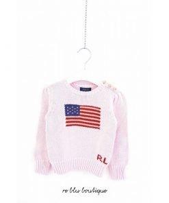 Maglione Polo Ralph Lauren a girocollo in cotone rosa con chiusura a bottoni laterali, i bottoni sono serigrafati, ricamo frontale con bandiera americana.