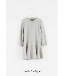 Vestito Polo Ralph Lauren in lana grigio melange, manica lunga e effetto volant sul fondo, logo polo cucito a cuore in bianco. Vestibilità regolare.