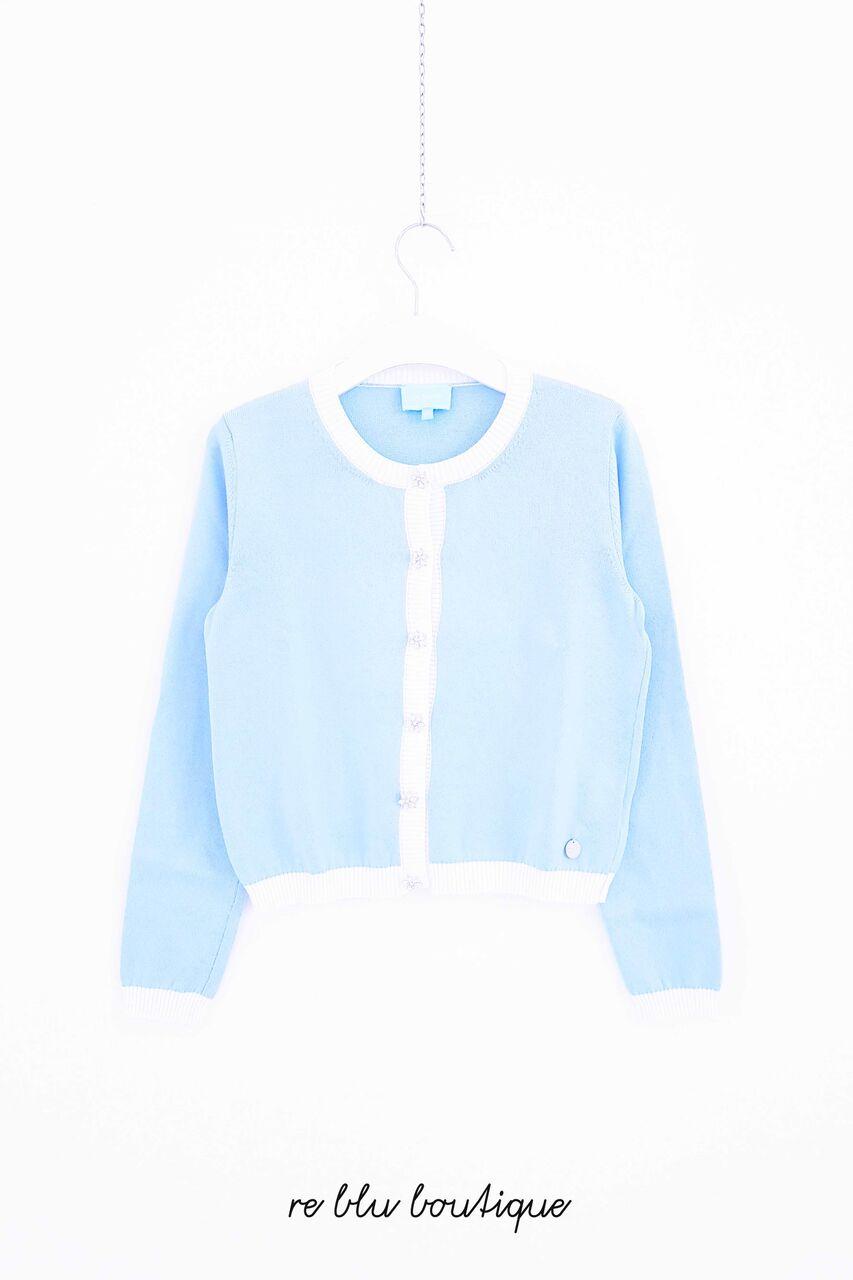 Cardigan Lanvin color azzuro cielo con profili a contrasto color bianco, bottoni gioiello, medaglietta con il nome sul fianco.