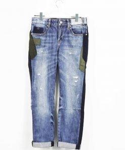 Jeans skinny bluette con toppe verdi militare e blu