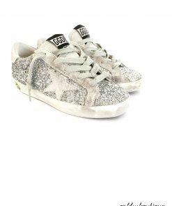"""Sneaker modello """"SuperStar"""" interamente ricoperto di glitter che il, brand definisce """"silver moon"""", motivo a stella in tono argento laterale, effetto vintage voluto, logo sul retro della scarpa."""
