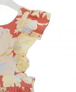 Vestito Bonpoint, fondo rosso con stampa di fiori gialli su tutta la superficie, senza maniche con leggero tulle sulle spalline, le spalline si incrociano sulla schiena