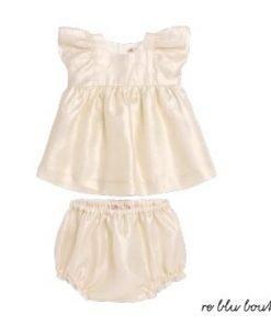 """Vestito in lino dorato Bonpoint, maniche corte con balze modello """"Lulu"""". Increspato in vita, è abbottonato sul retro per vestirsi facilmente. È venduto con il copri-pannolino coordinato"""