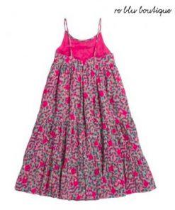 """Vestito modello """"Lucrèpce"""" Bonpoint, dalla forma bohémien svasata da sottili cinturini. In voile e crêpe, il suo tessuto rosa fucsia si abbina perfettamente"""