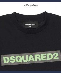 """T-shirt nera in cotone di Dsquared2. Modello girocollo con stampa frontale """"Dsquared2"""" in colore verde fluo. Mini Me: lo stile per i più piccoli ispirato alle collezioni dei grandi."""